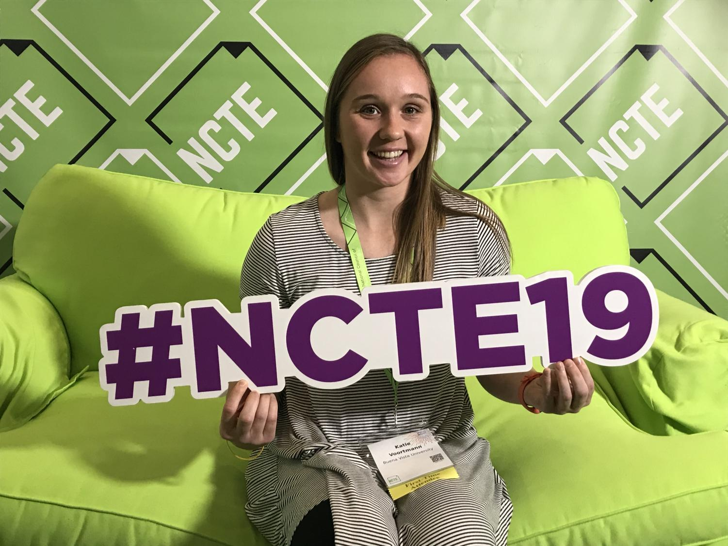 Katie Voortmann perches on the big green NCTE couch in Baltimore.