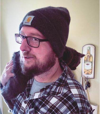 Jon Fisher with his cat, Beatrice.
